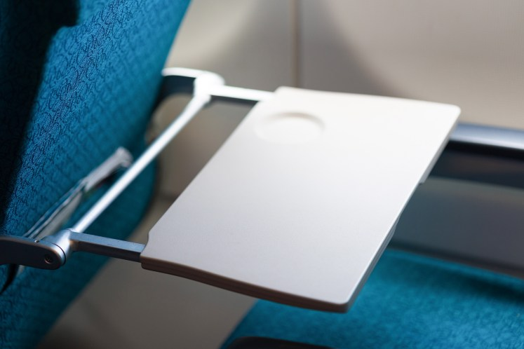 picture of a United airlines tray table.