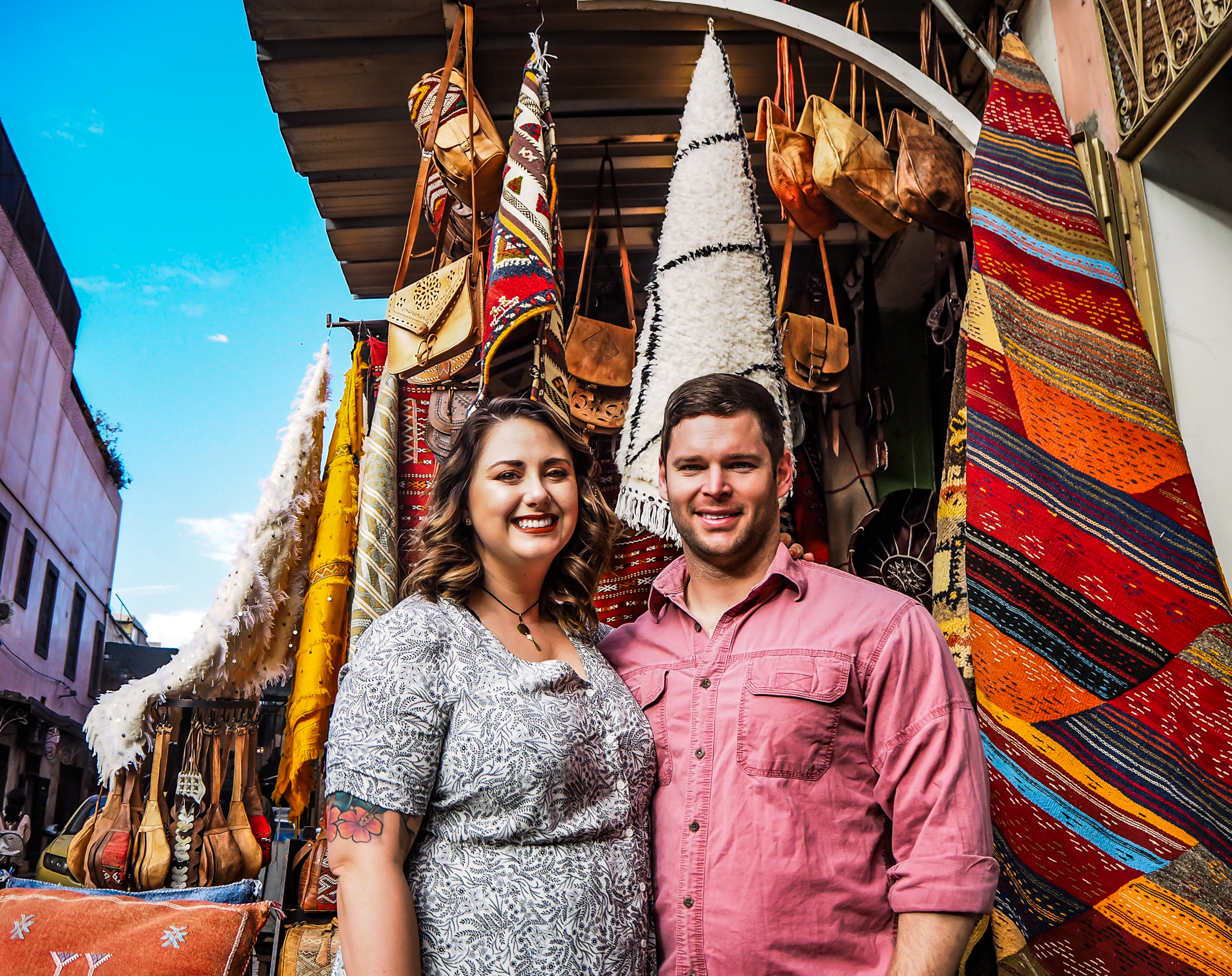 couple in front of moroccan rug shop