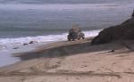 Jim gets away on the sands of Malibu beach.