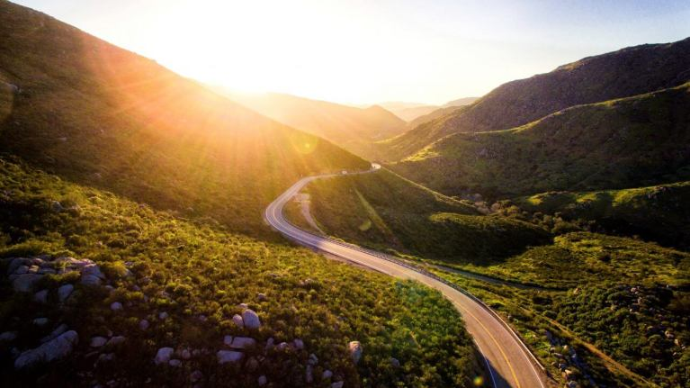 Road through grassy hills