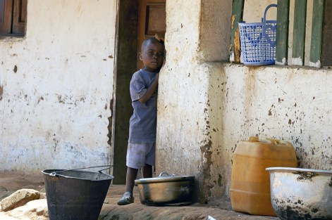 Around Libenge, a town in Sud-Ubangi District in the Democratic Republic of Congo . Walking around the dirt streets of the town, I was drawn by the figure of this child just daydreaming in the door of his house. I wish I knew what was he thinking about !