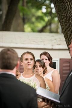 Backyard wedding ceremony by Sorrells Photography