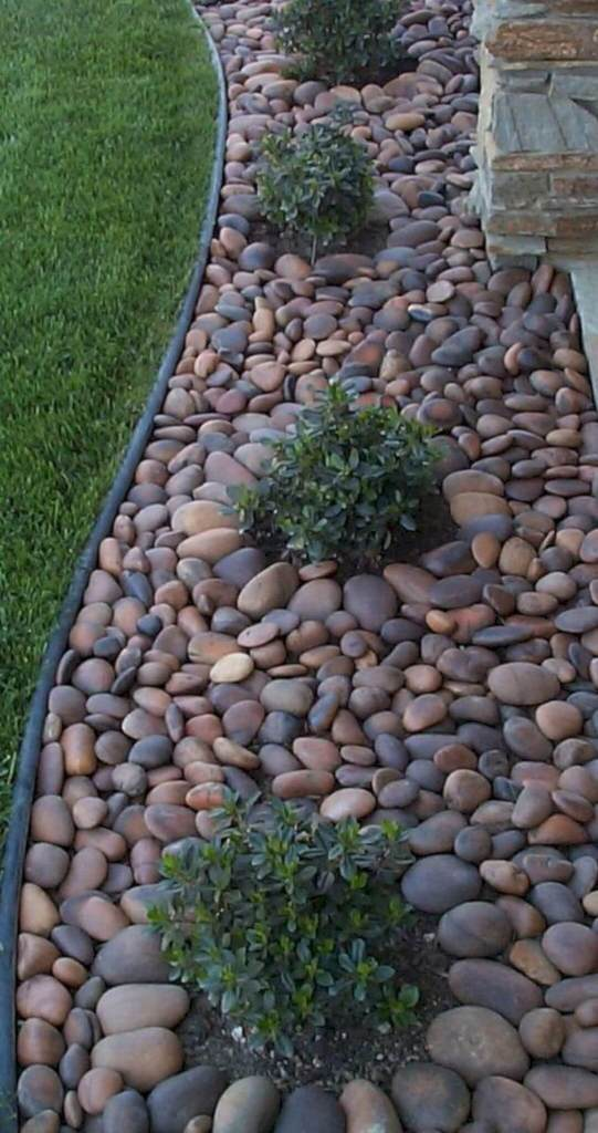 Stones around the Bushes - small backyard concrete ideas