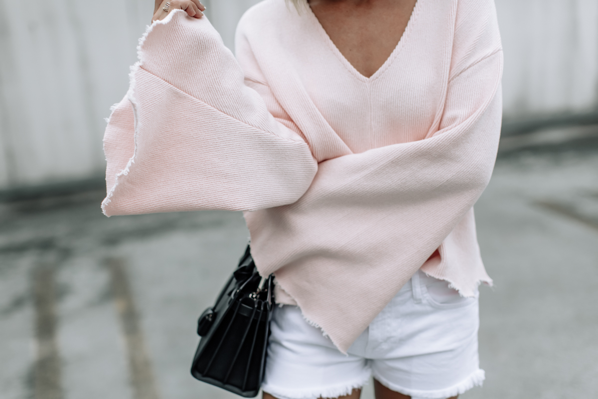 pink raw edge flare sleeved top
