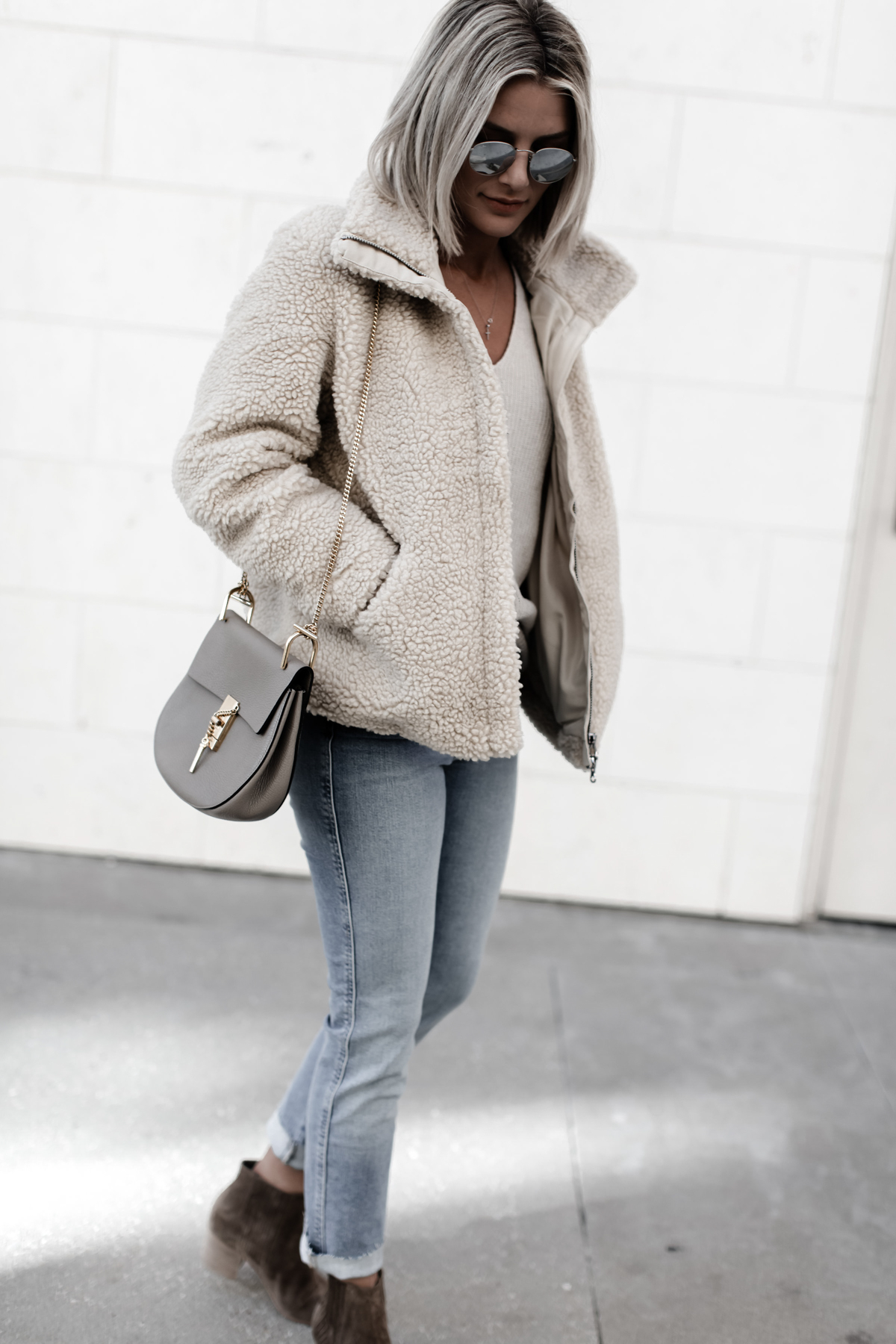 pile coat paired with jeans on Sage Coralli of So Sage Blog