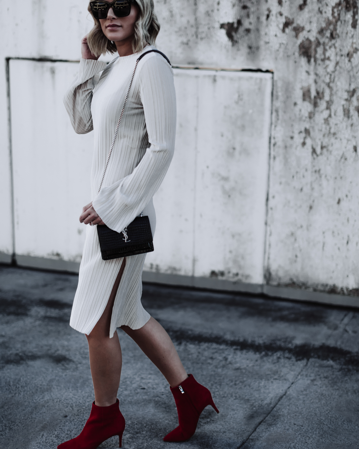 red booties and a pleated velvet dress on Sage Coralli