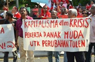 Rasisme dan Kapitalisme Berpisah Tiada! Lawan Kapitalisme untuk Membina Masa Depan yang Bahagia dan Aman untuk Semua!