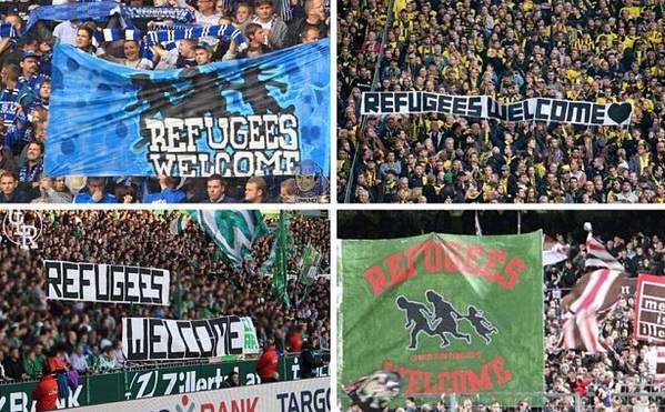 Fotballsupporter i Tyskland ønsker flyktningene velkommen.