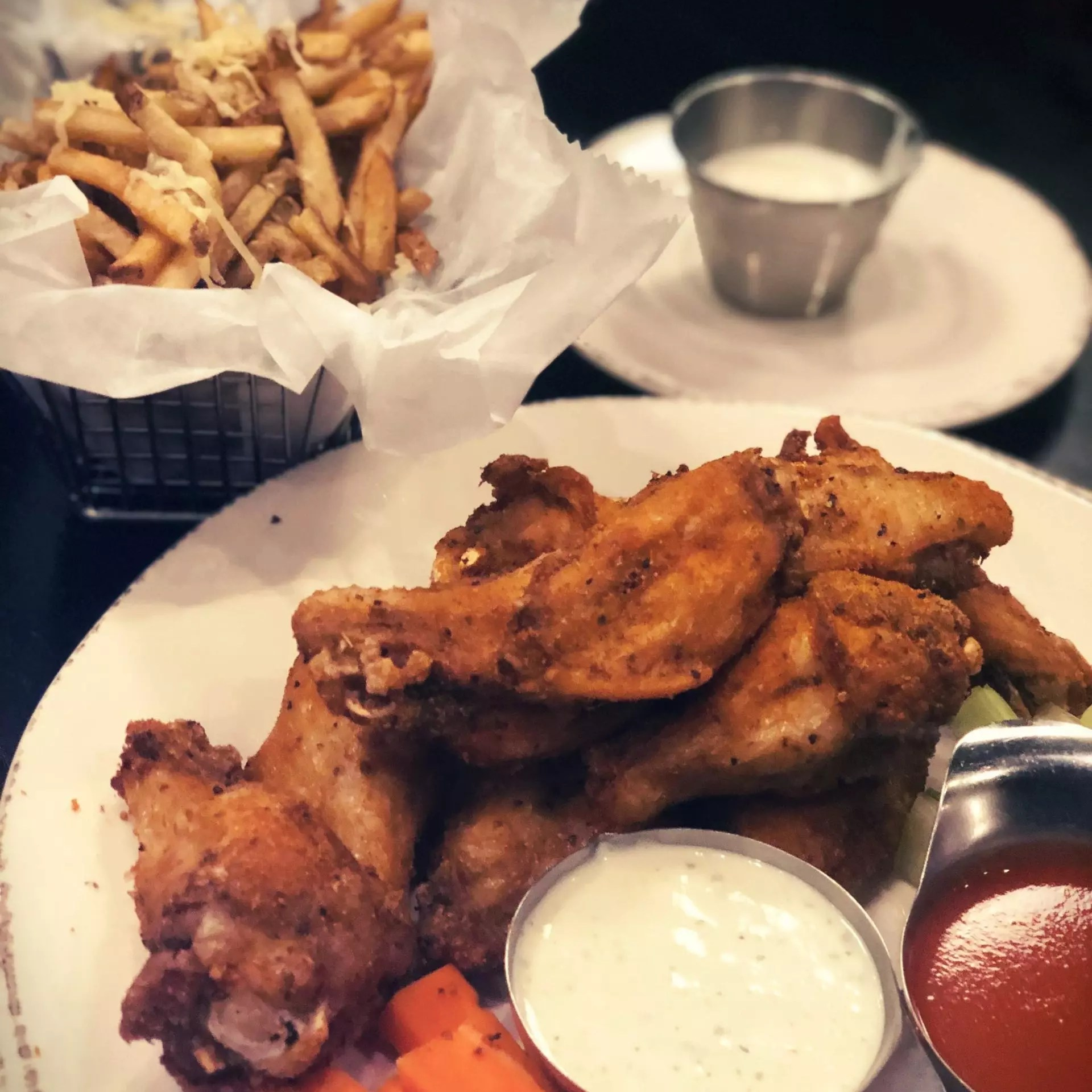 Picture of a plate of chicken wings from Fat City Kitchen.