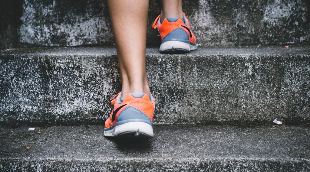 Woman climbing stairs. Like career advancement