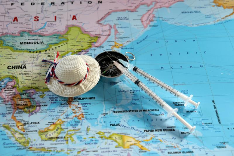 two-travel-vaccination-syringes-on-a-map