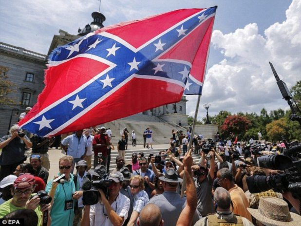 Reporters at the scene said New Black Panther Party members grabbed a Confederate flag and ripped it up