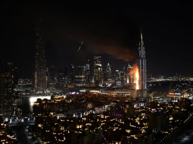 Sina Bahrami/@dearsina via AP Smoke and flames pour from a building which contains the Address Downtown Hotel, in Dubai, United Arab Emirates, Dec. 31, 2015.
