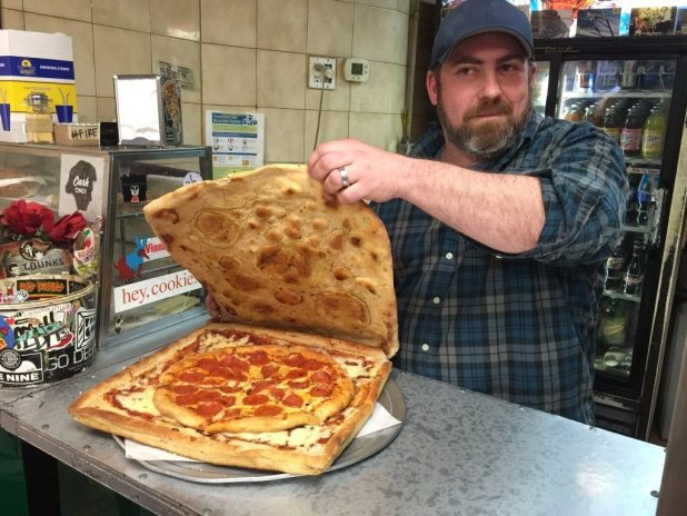 The pizza box pizza gives customers the option to eat the box and reduces cardboard waste. (Rick Boone/PIX11 News)