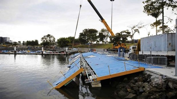 A ramp built for competitors' boats to reach the water hangs after collapsing at the Marina da Gloria sailing venue just days before the start of the Olympic Games. Photo: Reuters