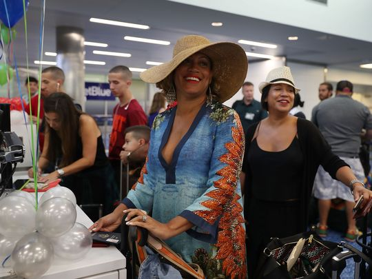 Erika Munro, left, and Michelle Sanchez-Boyce, right, check in at the ticket counter at Fort Lauderdale-Hollywood International Airport for JetBlue Flight 387 on August 31, 2016 in Fort Lauderdale, Florida. (Photo: Joe Raedle, Getty Images)