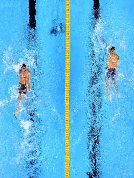 It was an epic battle between the two best swimmers in Olympic history.   Michael Phelps and Ryan Lochte faced off against each other in the 200-meter individual medley semifinals on Wednesday night – and the pumped-up crowd couldn't get enough of the action. (Some of the excitement was for Brazil's own Thiago Pereira, who was also competing.)