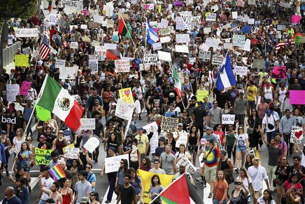 Protesters hold up signs during a march and rally against the election of Donald Trump in Los Angeles on Nov. 12. LUCY NICHOLSON / Reuters