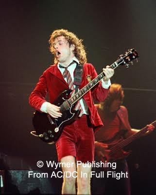 'AC/DC In Full Flight' Book Features Concert Photos From BON SCOTT, BRIAN JOHNSON Years