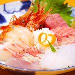"Smack in the fresh fish in one hand the sake in the Izakaya ""Yokocho"""