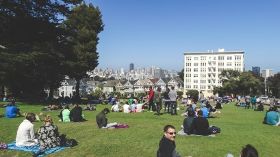 Alamo Square Park, packed with sunny weather, visitors, residents, and marathoners.