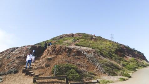 Steep hike in high winds on San Francisco's Twin Peaks