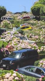 Cars careening down Lombard Street