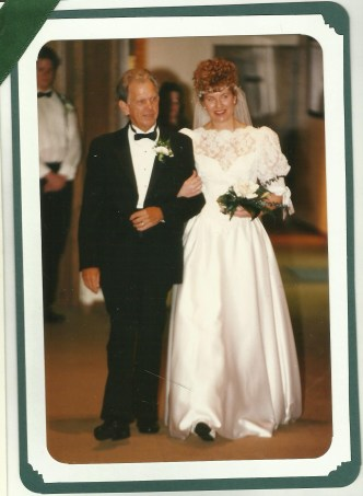 My dad walked me down the aisle and gave me away, despite my bird's nest hairdo.