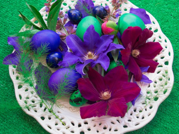 Easter eggs on a plate decorated with clematis