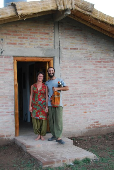 Gonzalo and Manna in front of their wonderful home