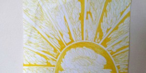 Illustration of sun in yellow ink