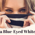 Blue eyes of a woman with the words Just a blue-eyed white girl