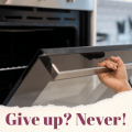 Open oven with the words Give Up? Never!