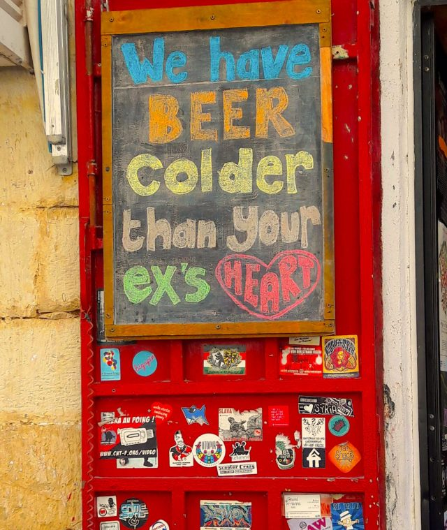 A bar sign which reads: we have beer colder than your ex's heart