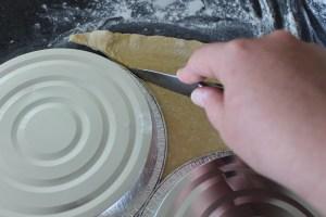 Using a sharp knife, cut around the pie tins.