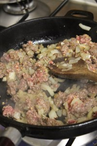 Turn up the heat. Add mince and brown.