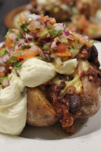 Top with a generous dollop of sour cream and tomato jalapeno salsa.