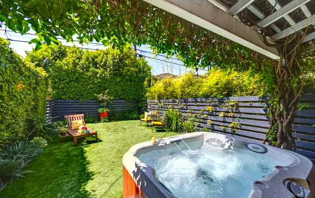 Yard and hot tub. Listing courtesy of Arleen Cohen – Keller Williams