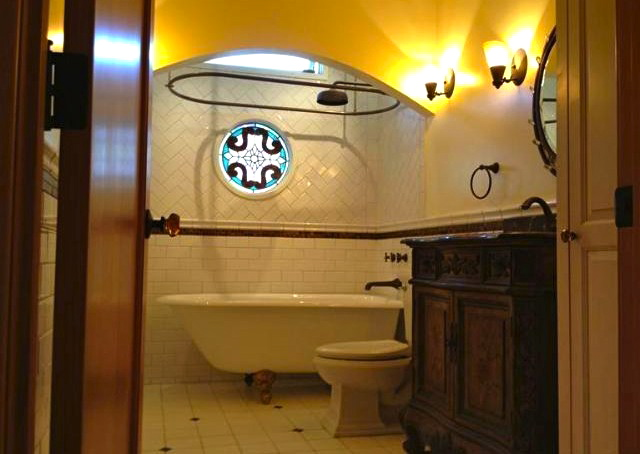 Bath with clawfoot tub, subway tile and period fixtures