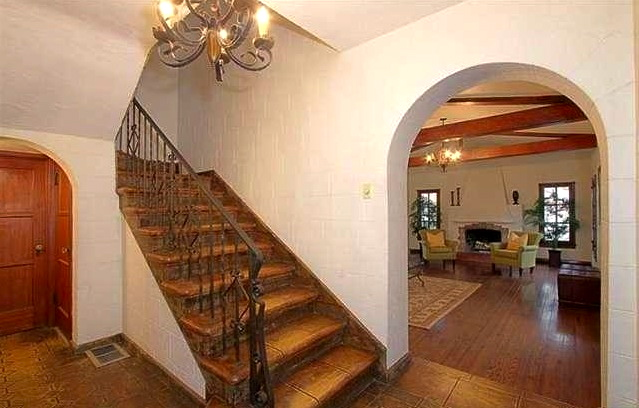 Entry foyer with original wrought iron fixtures and stairway