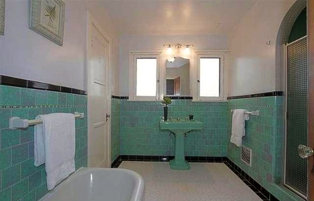 Master bath with original tile work, tub and alcove shower