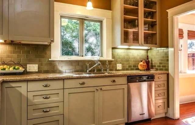 Upgraded kitchen with subway tile backsplash