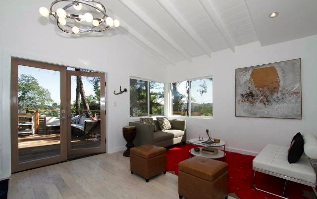 Living room with beamed and vaulted ceilings