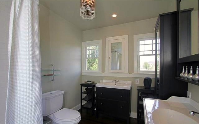 Bath with dual sinks
