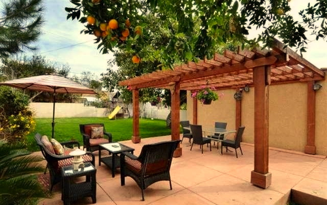 Pergola flanked patio and roomy backyard. Courtesy of Diane Walker – Dilbeck