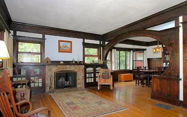 Living room with original Batchelder fireplace and wood floors