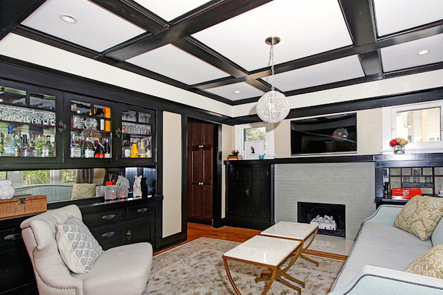 Living room with fireplace, coffered ceiling and built-ins