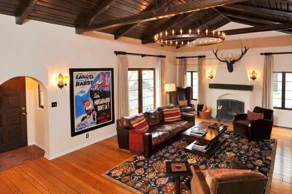 Dramatic living room with beamed/vaulted ceiling, fireplace and casement windows