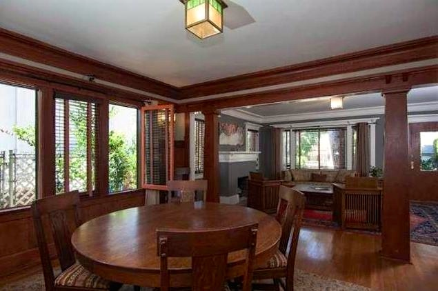 Dining room with moldings and casement windows