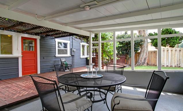 Yard and pergola flanked patio
